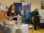 6 Volunteer Caroline selling raffle tickets at the fair